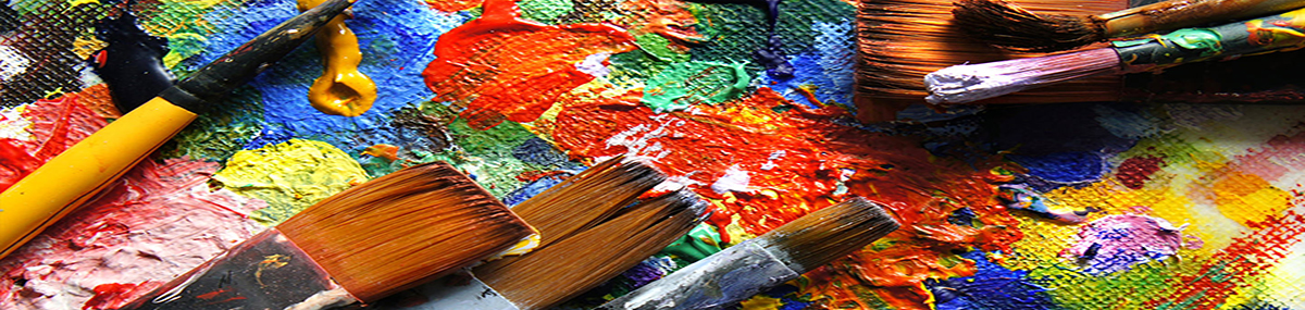 brushes and colorful paint on a palette board