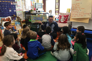 Tony Sinanis reading to a 1st grade class.