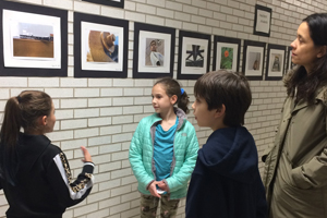 Grafflin fourth grader gives a tour of the school-wide photography project.