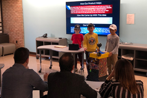 Three WO students presenting to sharks in the imagination tank.