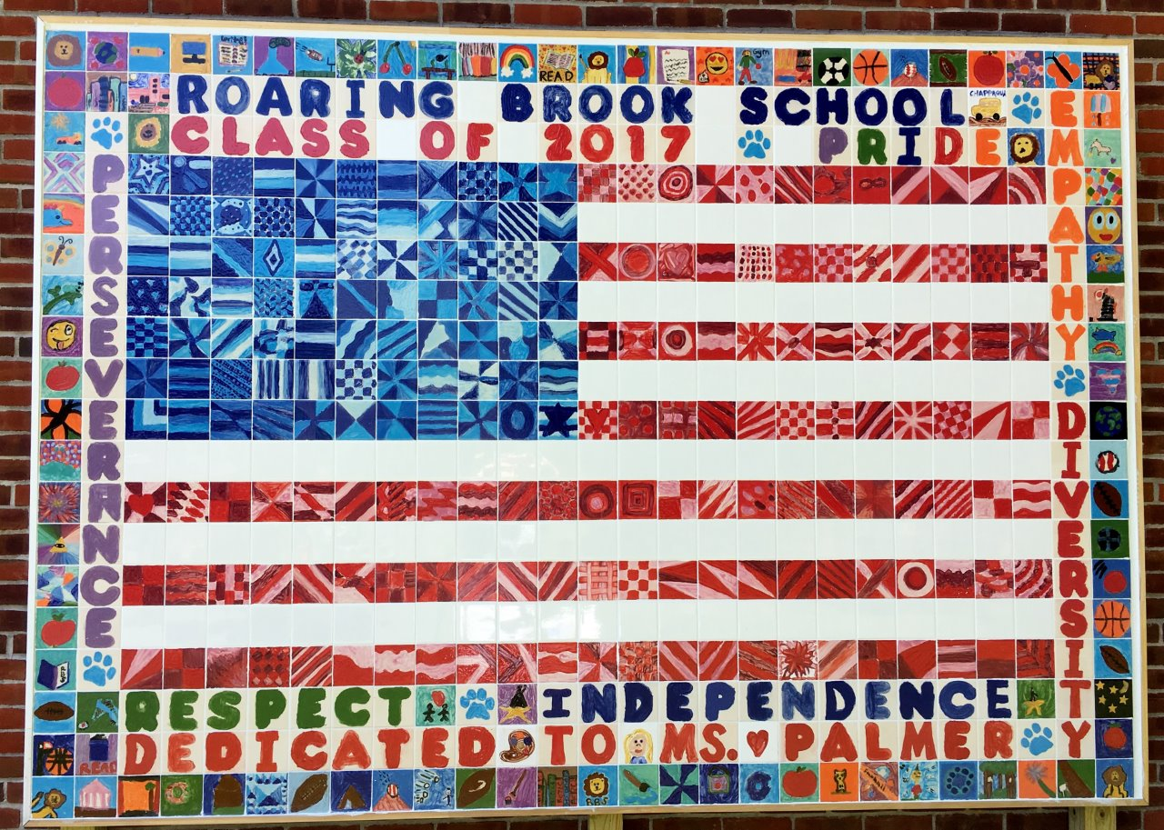 Mosaic ceramic flag mural made by students in 2016 at Roaring Brook